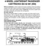Z 004 02 081 (959 )  4-wheel passenger car trucks with no couplers. Black. 1 pr.
